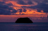 Sunset over island, Raja Ampat, Indonesia.