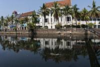 Dutch Colonial buildings by canal, Batavia, Jakarta, Indonesia.