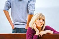 Teenage girl and boy sitting daydreaming