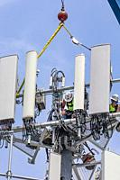 Detroit, Michigan - Workers upgrade an AT&T cell tower to the faster 5G technology.