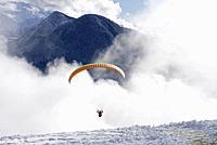 France, Haute Savoie (74), Alps, Passy, Plaine de Joulx, paraglider in winter.