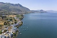 Aerial view of the Fuxian Lake coast with boats, Yunnan - China.
