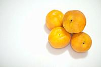 Spanish apricots heap. Isolated over white.