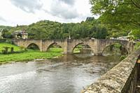 Estaing Midi Pyrenees Aveyron France, the village is one of the prettiest villages in France.Stone Bridge over Lot river.
