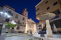 Sueras Castellon Plana Baja county Spain cityscape by dusk. Fountain at main square.