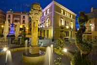 Segorbe town in Castellon province Spain fountain at town hall square with Christmas lights Alto Palancia region.