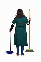 rear view of a portrait of a cleaning woman with broom and dustpan on white background.