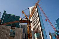 Singapore, Republic of Singapore, Asia - Construction cranes at a building site in the central business and financial district during the lasting coro...