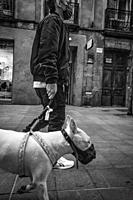 man with a dog in fuencarral street. Madrid. Spain.