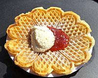 Waffel with cream and jam.