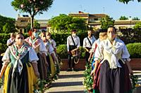 """Dancers with masks because of Covid-19 are preparing to dance """"""""Els Arquets dance"""""""". Corpus dance. Picanya. (València, Spain). June 2021."""