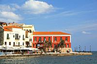 View to the Venetian style waterfront houses and traditional restaurants by the harbor in Chania city, Chania Province, Crete, Greek Islands, Greece, ...