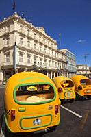 Coco taxis waiting for the tourists at the hotel zone in Center Havana, La Habana, Cuba, West Indies, Central America.