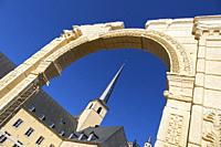 Europe, Luxembourg, Luxembourg City, Church of Saint John in Grund and the Neimënster Cultural Centre framed by Reproduction of ancient Stone Archway.