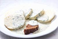 beef meat with dill sauce and dumplings.