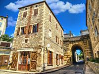 bridge over Grande Rue, Puy l Eveque, Lot Department, Occitanie, France.