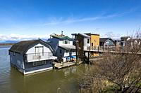 Floating houses on the Fraser River at Ladner, BC, Canada.