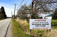 Warning sign on Westham Island, Ladner, British Columbia, Canada.