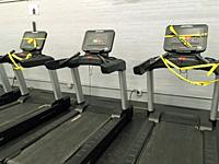 Treadmills with Caution Tape, in Secondary School Workout Room, Wellsville, New York, USA.