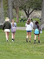 Middle School Girls Walking in Park, Wellsville, New York, USA.