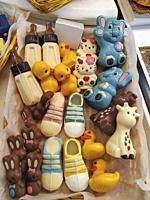 Varied chocolates for decoration of tarts.