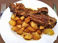 Lamb shank with baked potatoes.