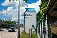 Singapore, Republic of Singapore, Asia - Street scene with Changi Business Park sign adjacent to the Expo MRT metro station located in Changi South ne...