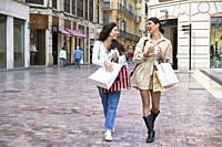 Two young girls enjoying a morning of shopping.