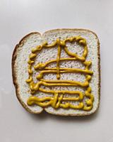 Loaf of Bread with Mustard.