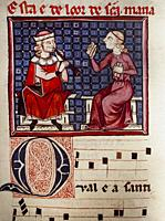 Medieval musicians. Woman sings, marks rhythm and play castanets while a man accompanies her on a shawm. Cantigas de Santa Maria by Alfonso X of Casti...