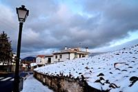 Rooves with snow in Real street of Bustarviejo, Madrid, Spain.