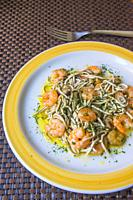 Gulas with prawns, garlic, parsley and olive oil. Spain.