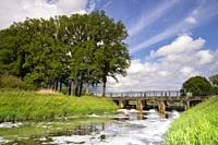 Weir in the river Aa close to Heeswijk castle in the Dutch village Heeswijk-Dinther.