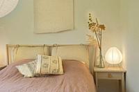 Stylish and cozy bedroom design Modern comfortable luxury master bedroom. Interior design. bohemian design decoration beautiful.