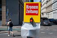 Vienna, Austria, Europe - Street scene with a coin-operated vending machine for the Kronen Zeitung in the centre of the Austrian capital city. The pap...