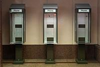 Singapore, Republic of Singapore, Asia - Old, inoperative public payphone booths without phones at an underpass.