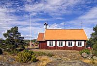 Beautiful traditional red wooden church in Holick on the Swedish Hornslandet peninsula at the Baltic sea.