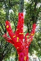 Artist Yarn Bombing by Accademia Aracne with his knitted trees at the exhibition 'Back to nature' 2021, installations of contemporary artists in Villa...
