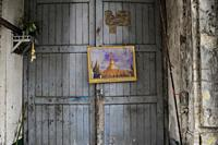 Yangon, Myanmar, Asia - A framed picture of the Shwedagon Pagoda hangs on the front door of an old building in the centre of the former capital city.