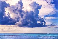 Colorful Large White Cloud Canoes Pier Blue Water Reef Moorea Tahiti French Polynesia. Different blue colors from lagoon and coral reefs and outer ree...