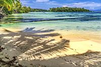 Colorful Hauru Point Beach Palm Trees Islands Coconut Blue Water Moorea Tahiti French Polynesia. Different blue colors from lagoon and coral reefs and...