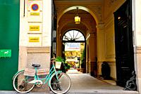 Shops and bike in Ayala street, Madrid, Spain.