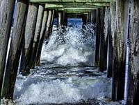 Waves hitting pier jutting out into the Atlantic Ocean, Virginia.