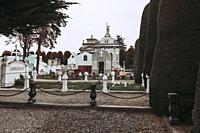 White cross and interior of the cemetery of Punta Arenas.