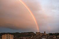 Valderrobres, Spain. December 15, 2020: Rainbow over View the medieval Village in Teruel province with Calatravo Castle.