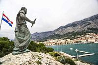 Side view of statue of St. Peter. St. Peter's Monument. Peninsula St. Peter. Makarska, Croatia, Europe.