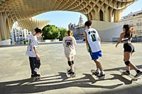 Group of young people riding on skateboard in the city.