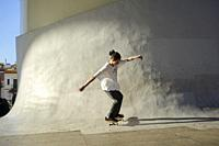 Young person riding on skateboard in the city.