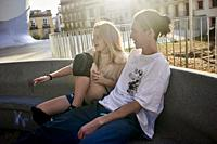 A young couple talking in the city.
