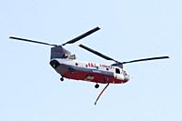 A Billings 4AJ helicopter which is designed for Aerial Fire Fighting, flies back after dropping its load in an effort to battle the Telegraph fire les...